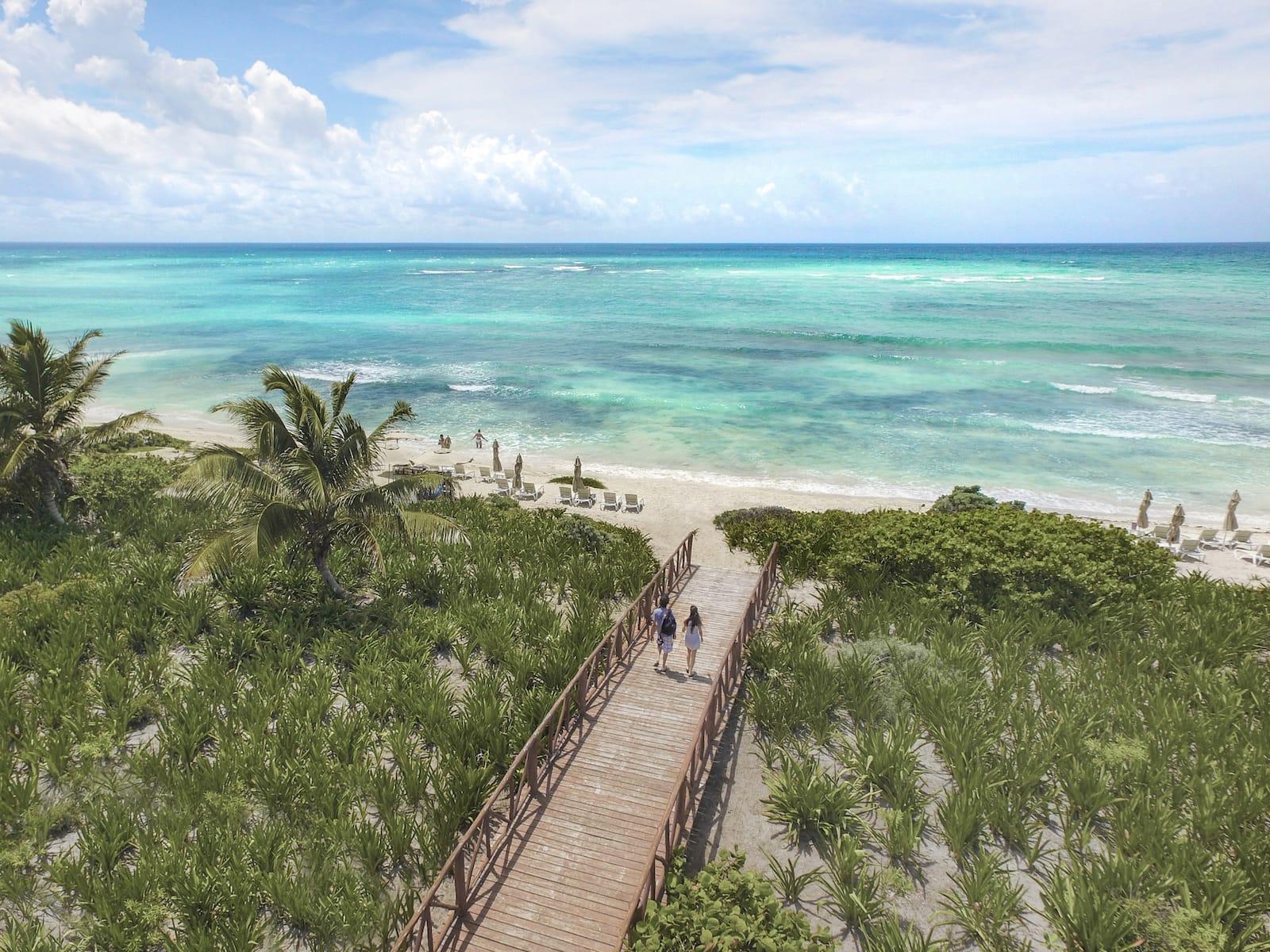 Beach walkway adventure all inclusive resort mexico romantic vacation