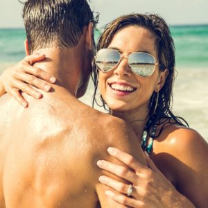 Couple on Beach Luxury Honeymoon