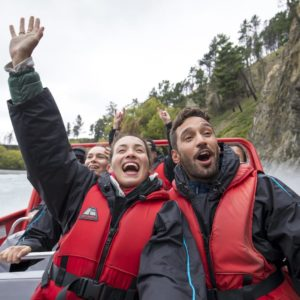 Hanmer Canterbury Couple having fun river boat adventure