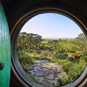 Hobbiton Matamata Waikato Lord of the Rings The Hobbit Vacation looking through the hobbit hole door