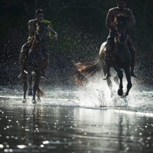 Tahiti HIVA Two Horsemen Riding Horses on Beach Ocean Tide Sea Spray