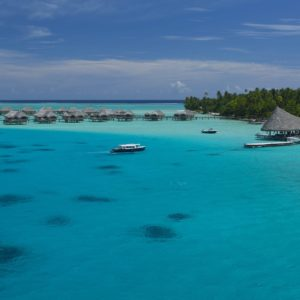 Tahiti Tahaa overwater bungalows boat in water pier