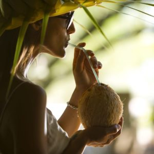 Tahiti Tikehau Woman Sipping Cocktail Cocanut Straw Hat