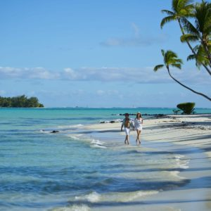 Tahiti bora bora couple walking on beach ocean palm trees