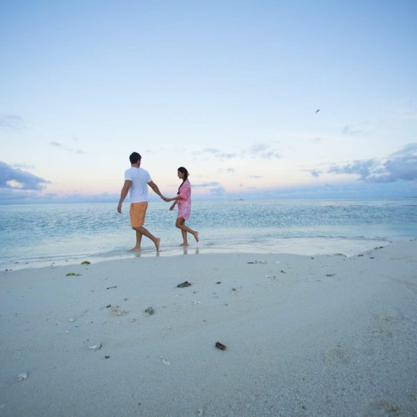 Tahiti bora bora couple walking on beach ocean sunset