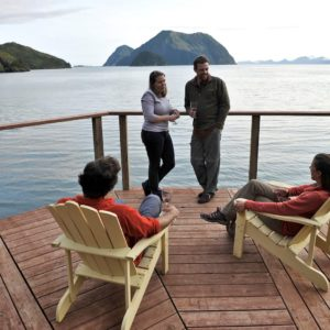 Alaska Luxury Vacation Seward Lounging Adirondack Chairs Friends