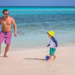 Father And Son On The Beach Playa Flamenco Cuba Luxury Vacation
