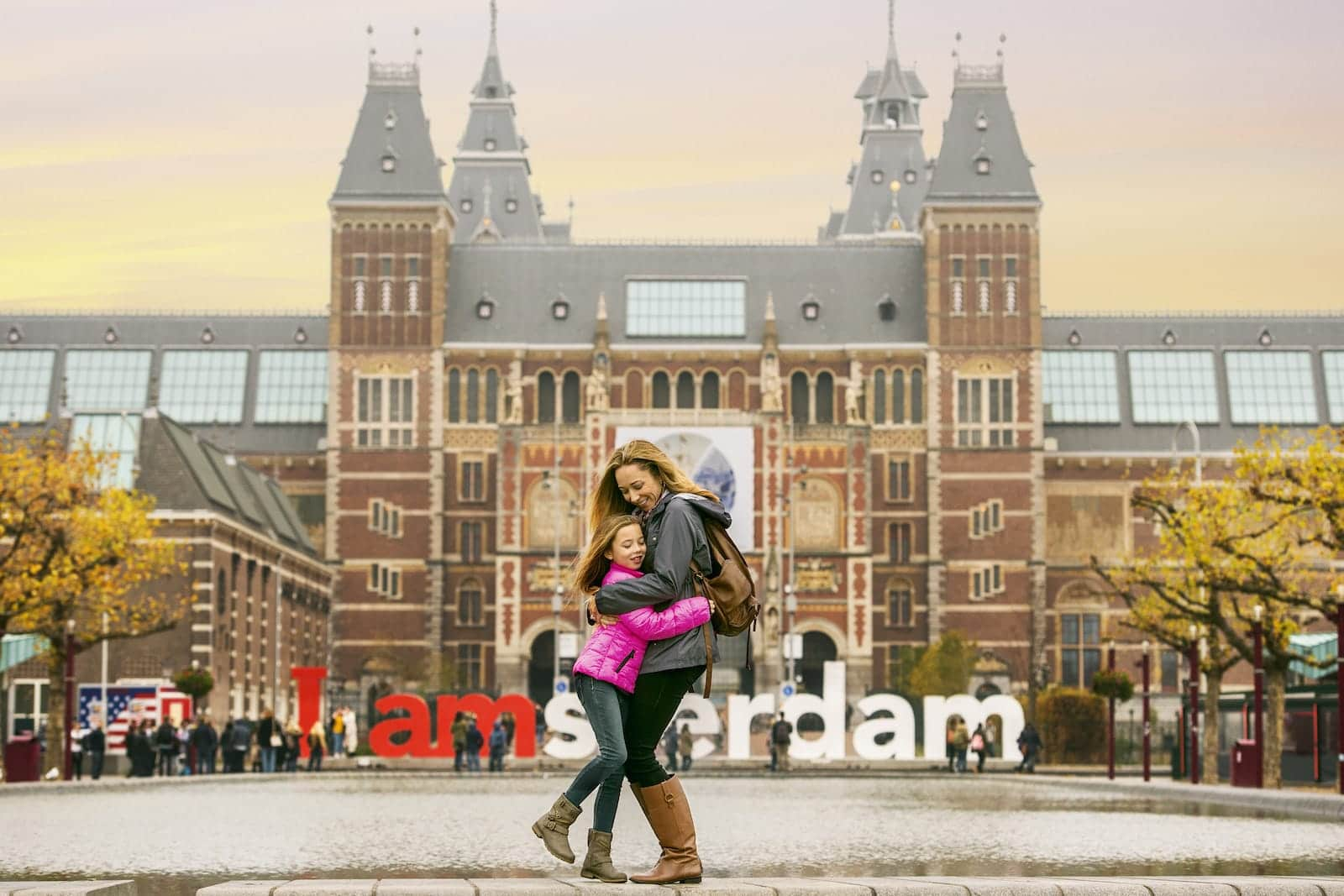Luxury Family Vacation With Kids Holland Mom Hugging Daughter With I Am Amsterdam Background