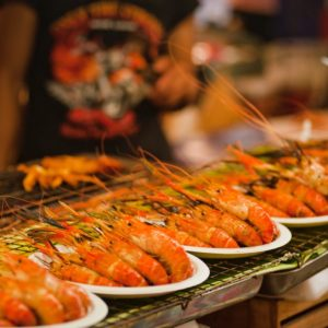 Luxury Thailand Vacation Pile Of Shrimps On Plates Bangkok Barbecue Close Up