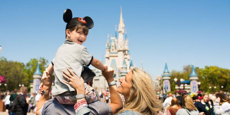 Walt Disney World Boy Riding On Dad Shoulders Magic Kingdom Cinderella Castle Mom